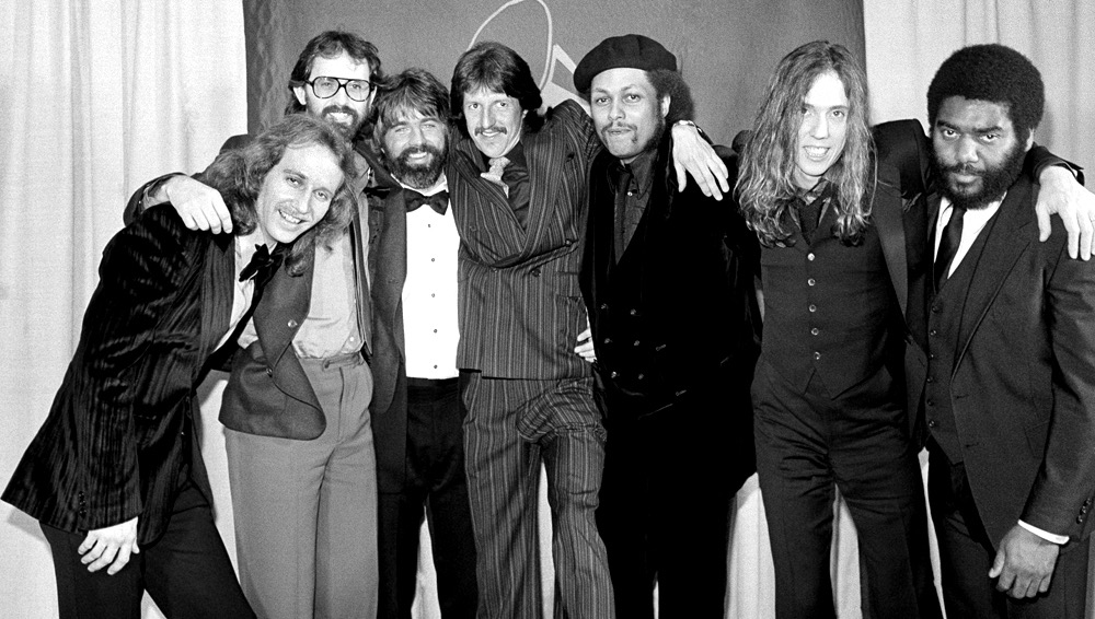 "Members of the group The Doobie Brothers huddle together backstage at the 22nd Annual Grammy Awards presentation in Los Angeles on Wednesday, Feb. 27, 1980, after they garnered four Grammys. Their ""What a Fool Believes"" was named record of the year and also won top songwriting and arrangement honors for group member Michael McDonald, third from left. McDonald shared song-of-the-year award for the tune with songwriter Kenny Loggins, not seen. The Doobies ""Minute By Minute"" was named best pop vocal performance by a group. (AP Photo/Lennox McLendon)"